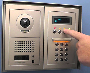 Hand pointing and using intercom system