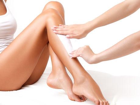 Woman-Having-Her-Legs-Waxed.jpg