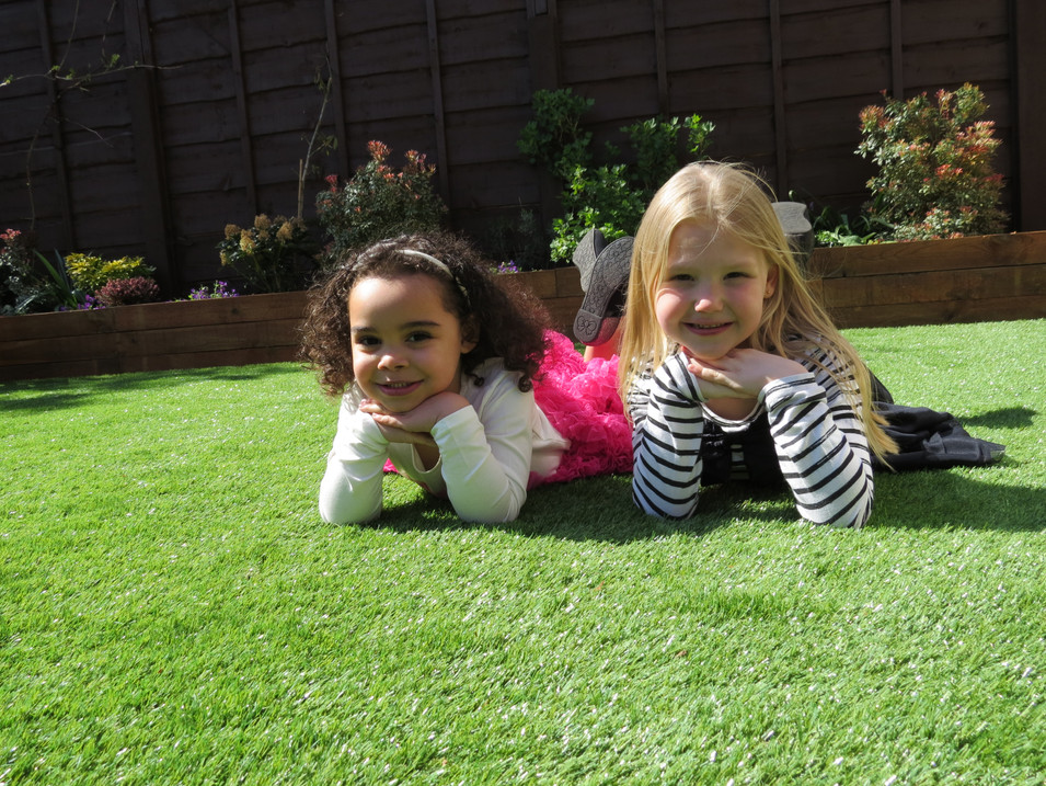 Two Girls on Artificial Grass