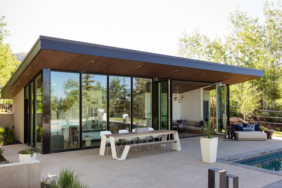 the-bi-fold-glass-wall-opens-up-to-and-c