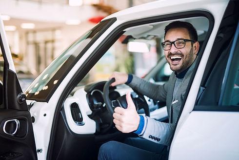 happy-satisfied-customer-just-bought-brand-new-car-vehicle-dealership.jpg