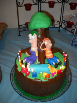 Ammon's Phineas and Ferb cake.jpg.jpg.jpg the tree would NOT stay on.jpg I have to figure out someth