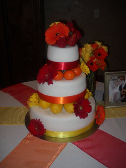 This was a wedding cake where the colors were orange, red, and yellow