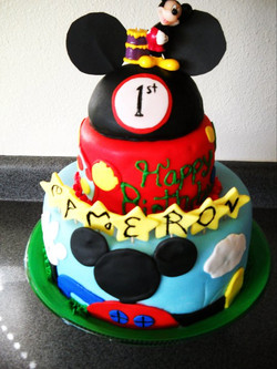 7th_ Cameron's 1st birthday.jpg It was mickey mouse clubhouse theme.jpg So fun! the top is cake too