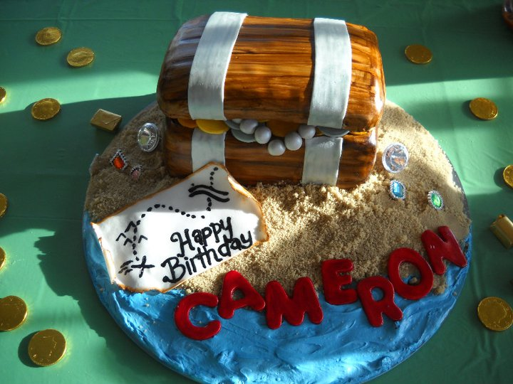 This is Cameron's birthday Cake. Its a treasure chest cake. The _sand_ is brown sugar and the _water