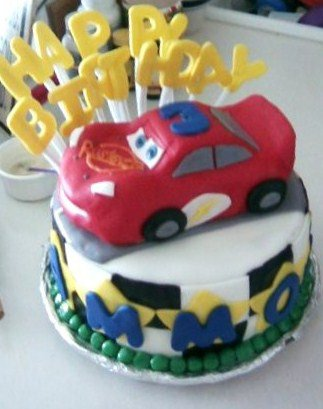 4th cake- My first carved cake, the car is made of cake that I carved into the shape of lightening m