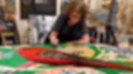 Beth Brown painting in her studio.jpg