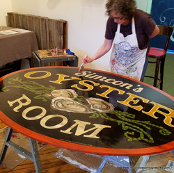 Hand painted sign by Beth Brown