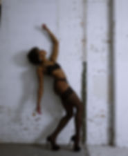 Nicki Cheri a fit natural hair black woman posing in lingerie indoors detroit