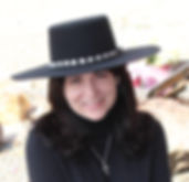 Nancy Quinn in black flat brimmed hat with silver band.