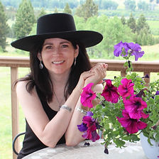 Nancy with flowers.JPG