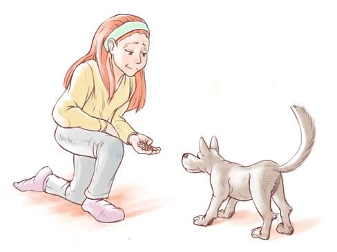 En pige, som fodrer sin hund