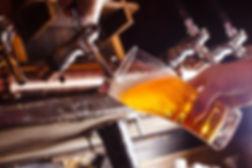 The bartender pours fresh light beer.jpg