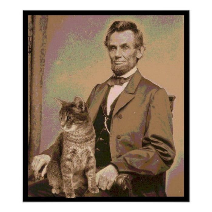 President Abraham Lincoln sitting for a portrait with his pet cat sitting on his lap