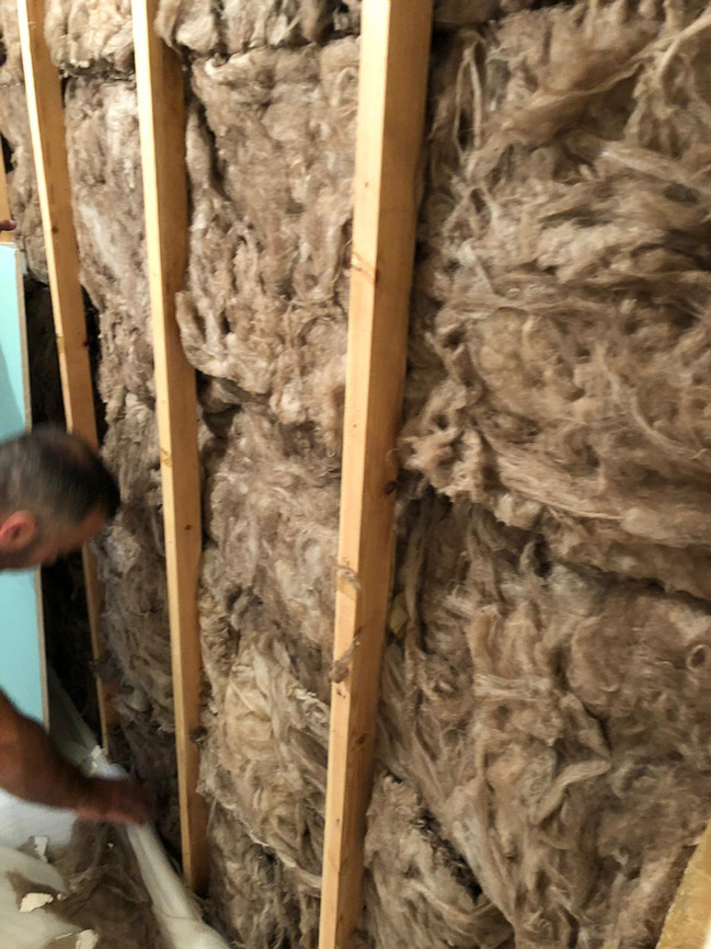 Insulated correctly with rockwool and correct plasterboard thickness.