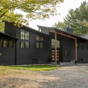 Entrance to Black Modern Cottage