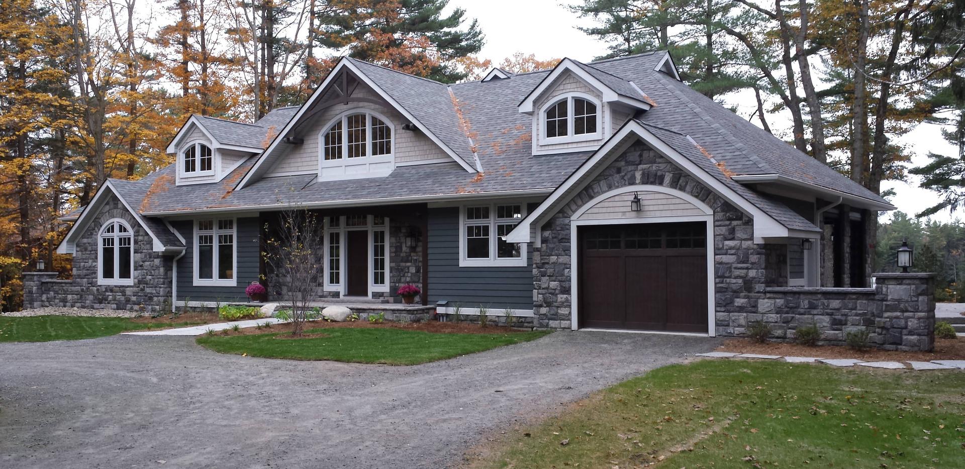 Intricate Roof Lines on Large Grey Cottage Muskoka