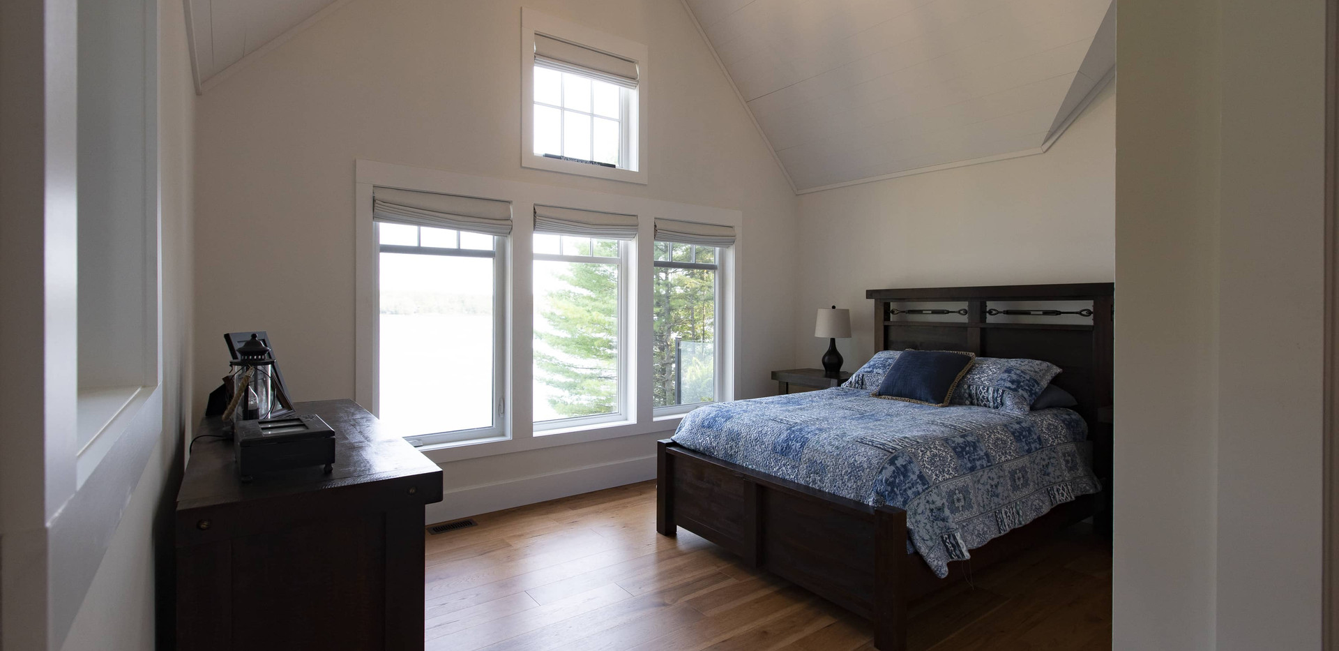 Large Cottage Bedroom with Floor to Ceiling Windows