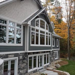 Large Windows Facing Lake in Modern Cottage