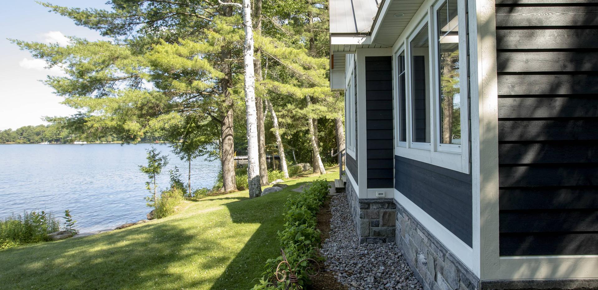Small Blue Cottage on Water Edenlane Muskoka
