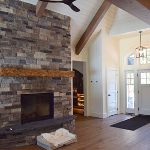 Floor to Ceiling Cottage Fireplace Wood Beams