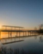 Lake sunrise over bridge.jpg