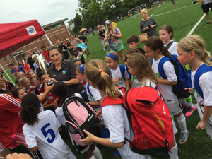 Coach Annie celebrating with her 2009 Girls after receiving the 1st place trophy