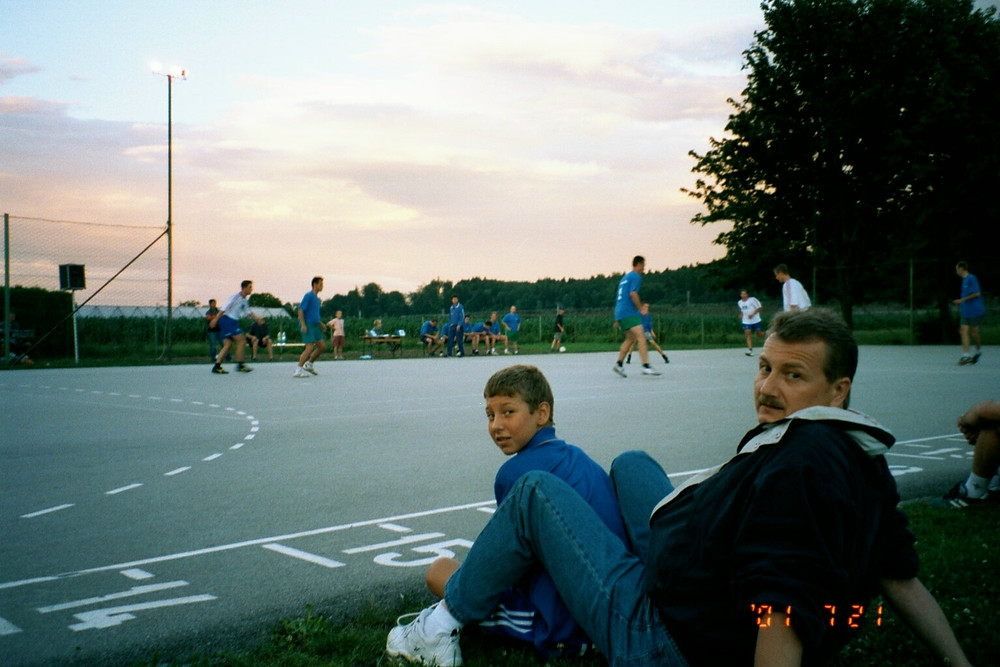 Nikki watching futsal in Slovenia with his dad.