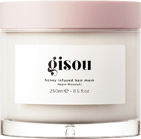 Gisou Honey Infused Hair Mask, clear glass jar with a thick bottom, has a pink plastic lid.