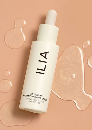 True Skin Radiant Priming Serum from the brand Ilia, small light cream colored dropper bottle.