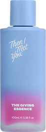 Photo of Then I met you's serum, its a tall blue glass bottle.