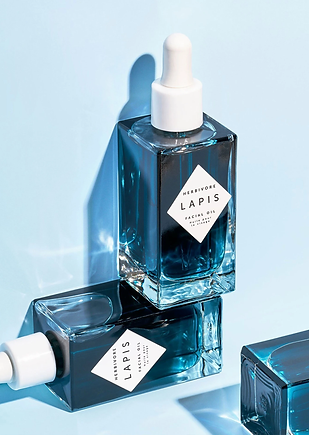 Lapis Facial Oil from the brand Herbivore Botanicals, small square bottle with a deep blue liquid inside.