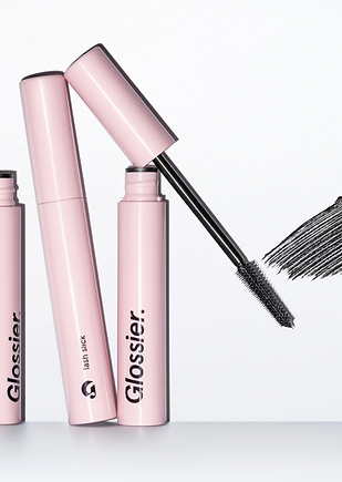 Lash Slick Mascara from Glossier, it's millenium pink with black sans serif text.