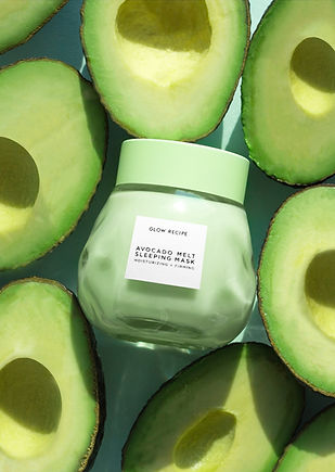 Avocado Melt Sleeping Mask from the brand glow recipe, small glass jar with a green lid and the cream inside is also green