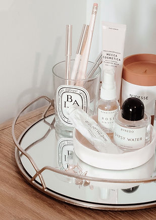 photo of a tray with cosmetics product that have a minimalist design.