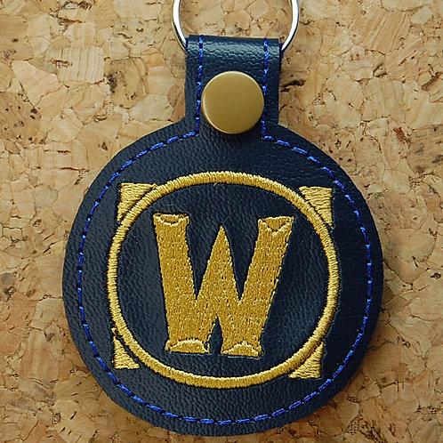 War video game logo snap tab key fob - blue/gold