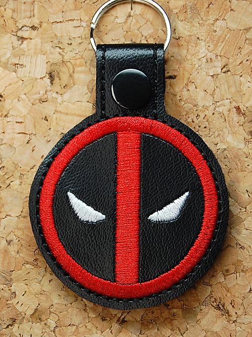 Anti-hero symbol snap tab key fob - red/black