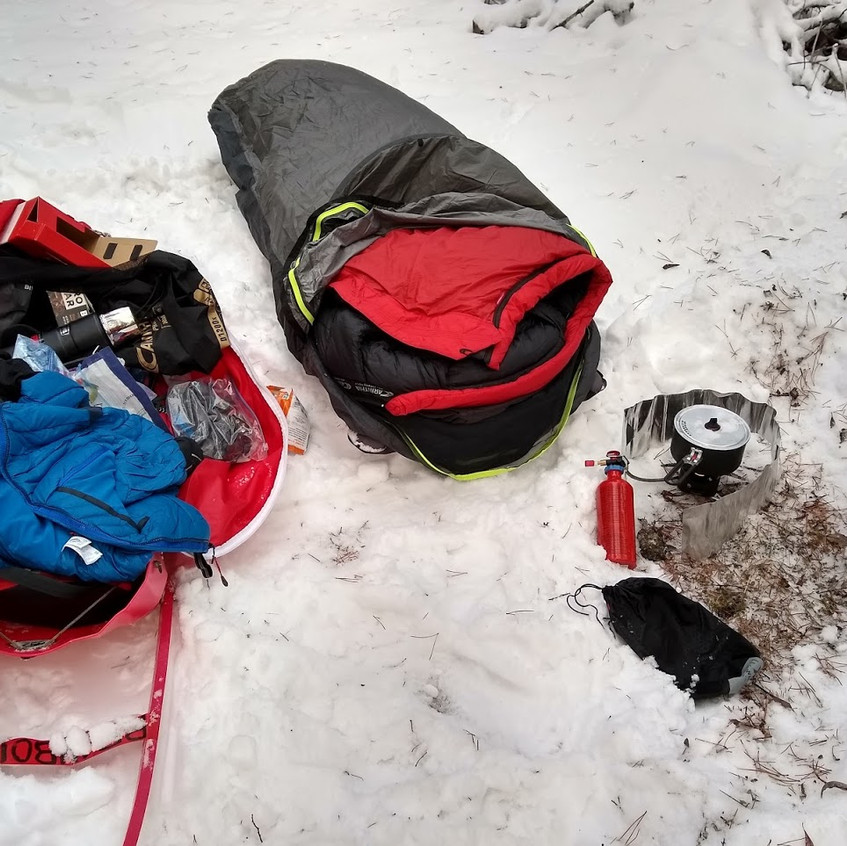 Sled and gear bag, sleeping bag and bivy sac and stove with fuel tank