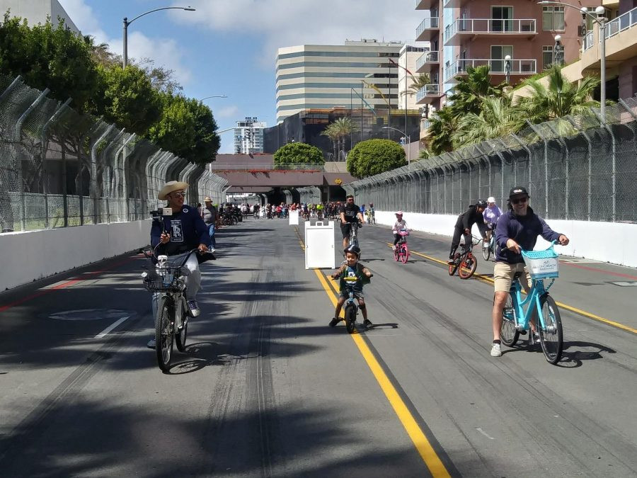 Family bike riding through Long Beach for the Open Streets Initiative