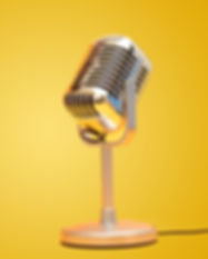 Retro vintage microphone on yellow backg