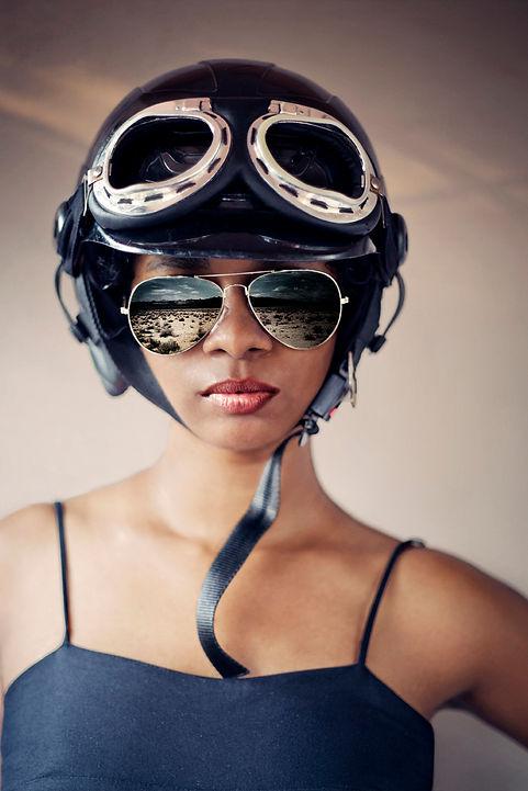 self portrait of a woman wearing a helmet