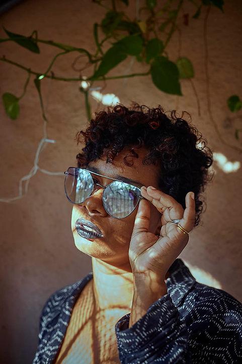 self portrait of a woman wearing glasses