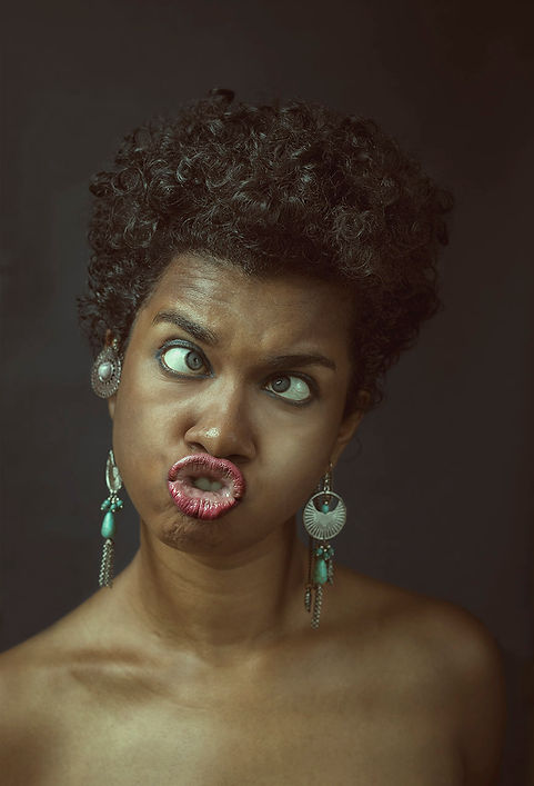 portrait of a woman with curly hair making funny expression