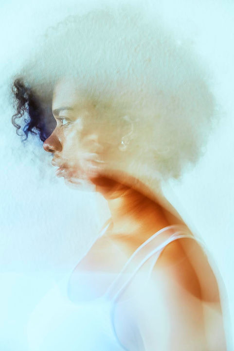 portrait if a woman with curly hair