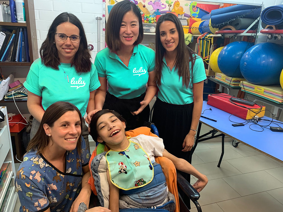 Lulu team at Fundación Amigos de Jesús with boy and caregiver.jpg
