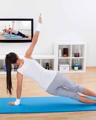 Woman practicing yoga at home standing o