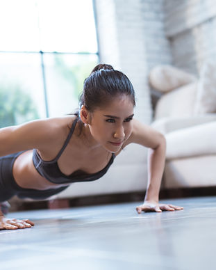 Asian women exercise indoor at home she