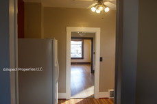 Refrigerator in kitchen and view into rest of house