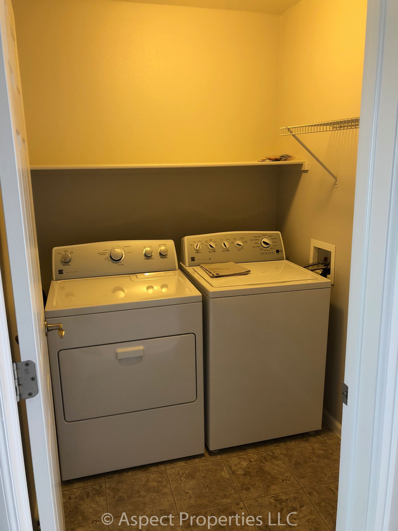 Laundry room with new washer and dryer