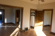 View of hallway and bedrooms from living room